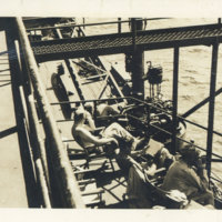 People relaxing on the deck of USS General W. M. Black