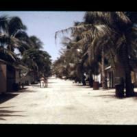 Two scenes along the main road in Ebeye village.