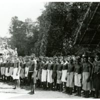 Natives of Green Island line up behind their chief…
