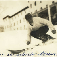 A Japanese ski instructor showing ski technique at…
