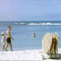 Surfers and tourists at a beach