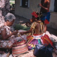 Girl and elder preparing for Outer Islands High School…