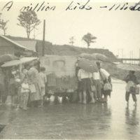 Kids surrounding a jeep on a rainy day, Mito, Ibaraki,…