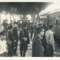 Kaizawa 2-137: Japanese policemen waiting at Tsuruoka…
