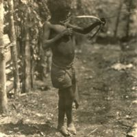 [Boy with toy bow and arrow]