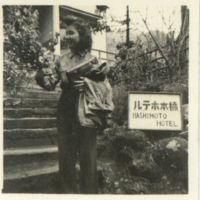 Kaizawa 2-075: Midori Kawaguchi posing with flowers at…