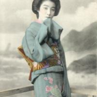 [A woman in a blue kimono ]