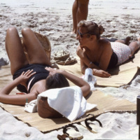 Tourists sunbathing on a beach