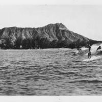Surfers at Waikiki with Diamond Head