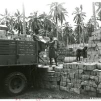 Guadalcanal supplies: unloading beer at rations dump