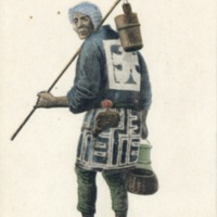 [A man in a traditional cloth holding fishing tools]