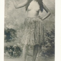 [A Hawaiian woman in a traditional Hawaiian skirt]