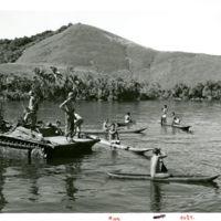 Natives living near Lake Sentani, NG, row out to…