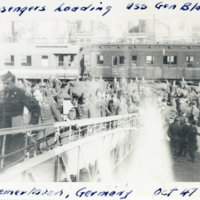 Passengers in uniform heading USS General W. M. Black…