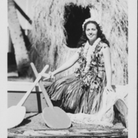 Woman in Ti-leaf Skirt with Paddles