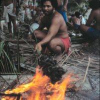 Man Roasting Food on Fire