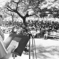 Speaker [man, outdoors, at podium]