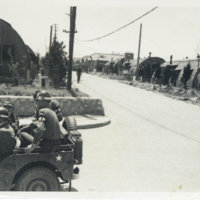 MPs riding on an Army jeep, Japan