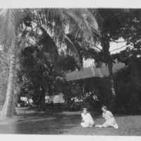 [060] Two People Sitting on Grass