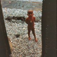 Young Boy Standing in Doorway