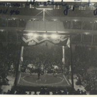 Two Sumo wrestlers and a referee in the Sumo ring with…