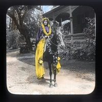 Woman pa'u rider wearing lei on horseback (Adele…