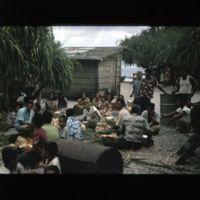 Benet's kemem. Group of Kilians preparing to eat.