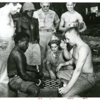 Pfc. Wm. F. Fey (sitting right) finds out that the…