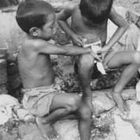 Boys with can of corned beef, Ujelang, 1968.…