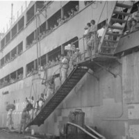 Loading Okinawans aboard the Tsukushi Maru for…