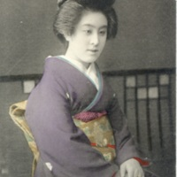 [A woman in kinomo sitting in a formal posture]