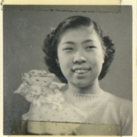A smiling Japanese girl in a dress with an angel…