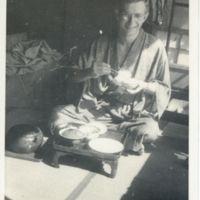 Kaizawa 2-119: Alexander Calhoun in yukata eating a…
