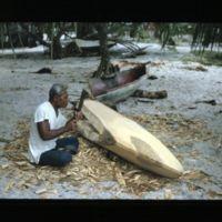 Laijo working on Jorri's canoe.