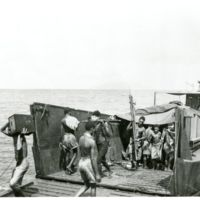 Natives unloading the barge containing supplies for the…