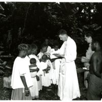 Three infant natives of Guadalcanal are baptized by…