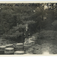 Aileen Kerrigan strolling on stepping stones in a pond…