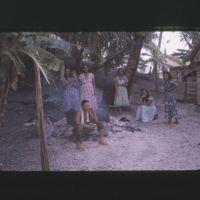 Women preparing Jojej's oil drum um.