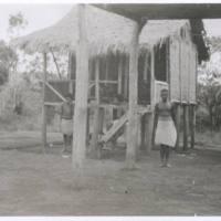 Native hut & Rego boy - near Hom Brom. N.G. '43