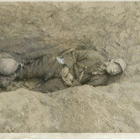 A dead soldier laying in a ditch in Okinawa