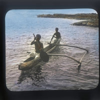 Two boys paddling an outrigger canoe