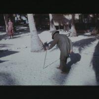 Lokwiar walking with cane.