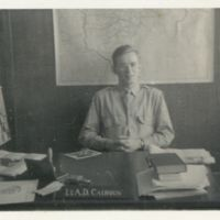 Kaizawa 3-016: Alexander Calhoun sitting at his desk in…