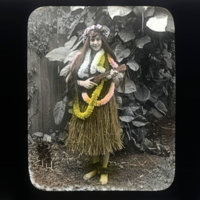 Young woman wearing grass skirt, leis holding a ukulele