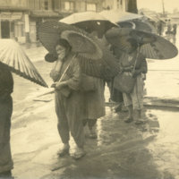 Japanese women holding traditional paper umbrellas…