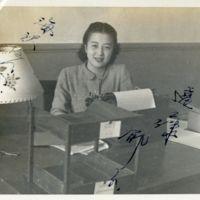 Kaizawa 3-017: Image of Endo Ikuko 遠藤郁子 sitting at a…