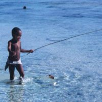 Boy with Long Stick at Beach