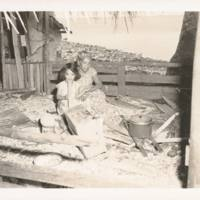 Woman and child in native-built cook shack on Ejit