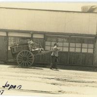 Two Japanese pulling a cart on a street, Sendai Migagi…