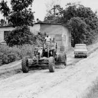 A road on Koror being leveled by a grader, 1969.…